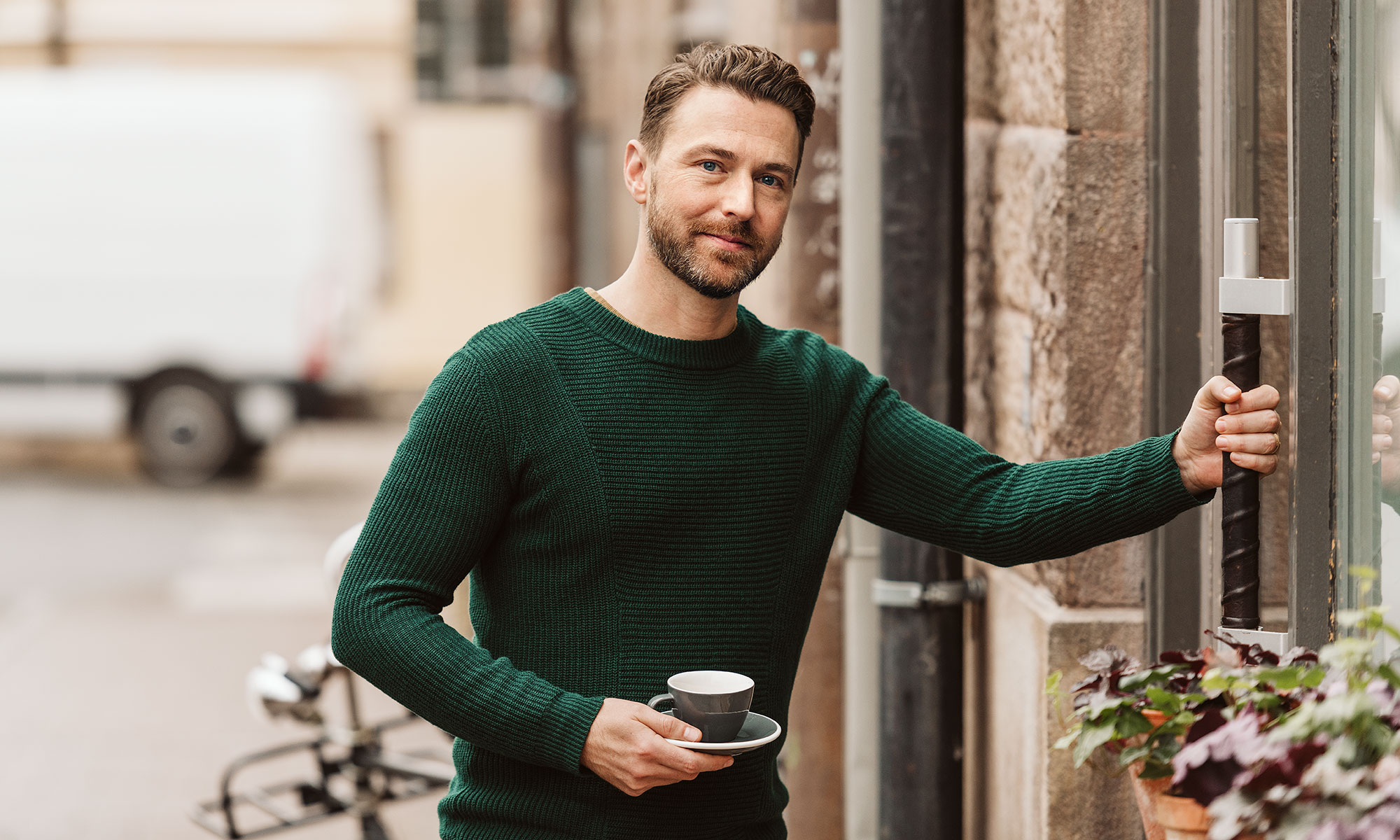 Man holding coffee cup.